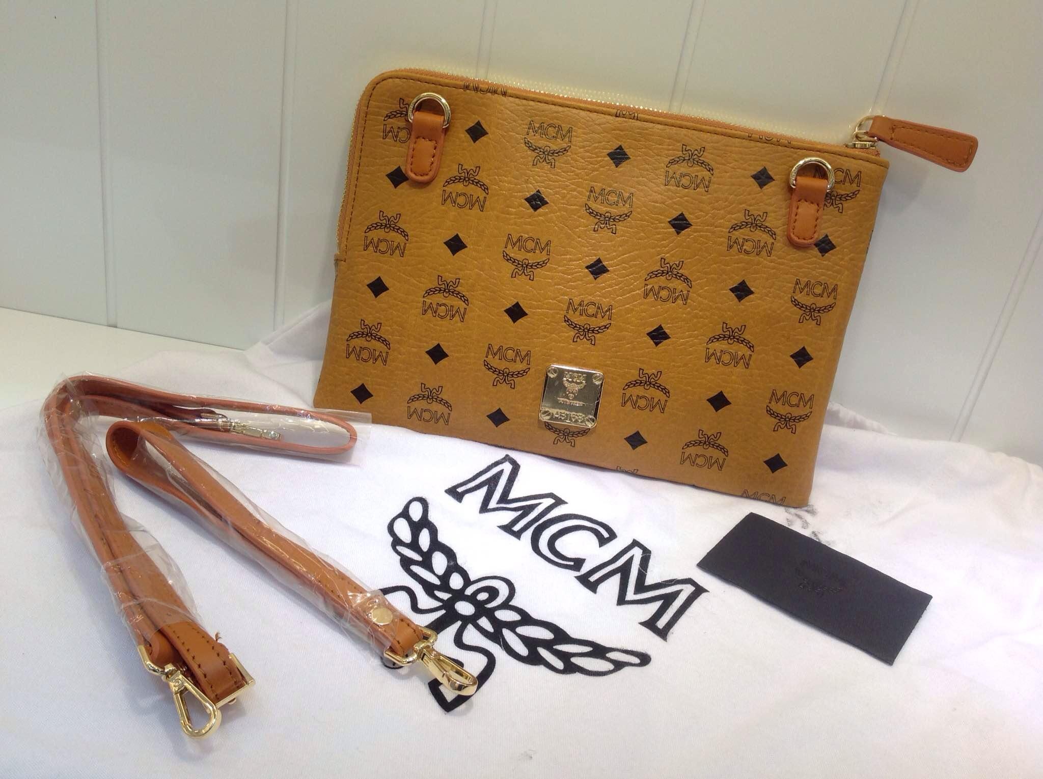 2015限量版铆钉带钻 MCM手包 时尚引领
