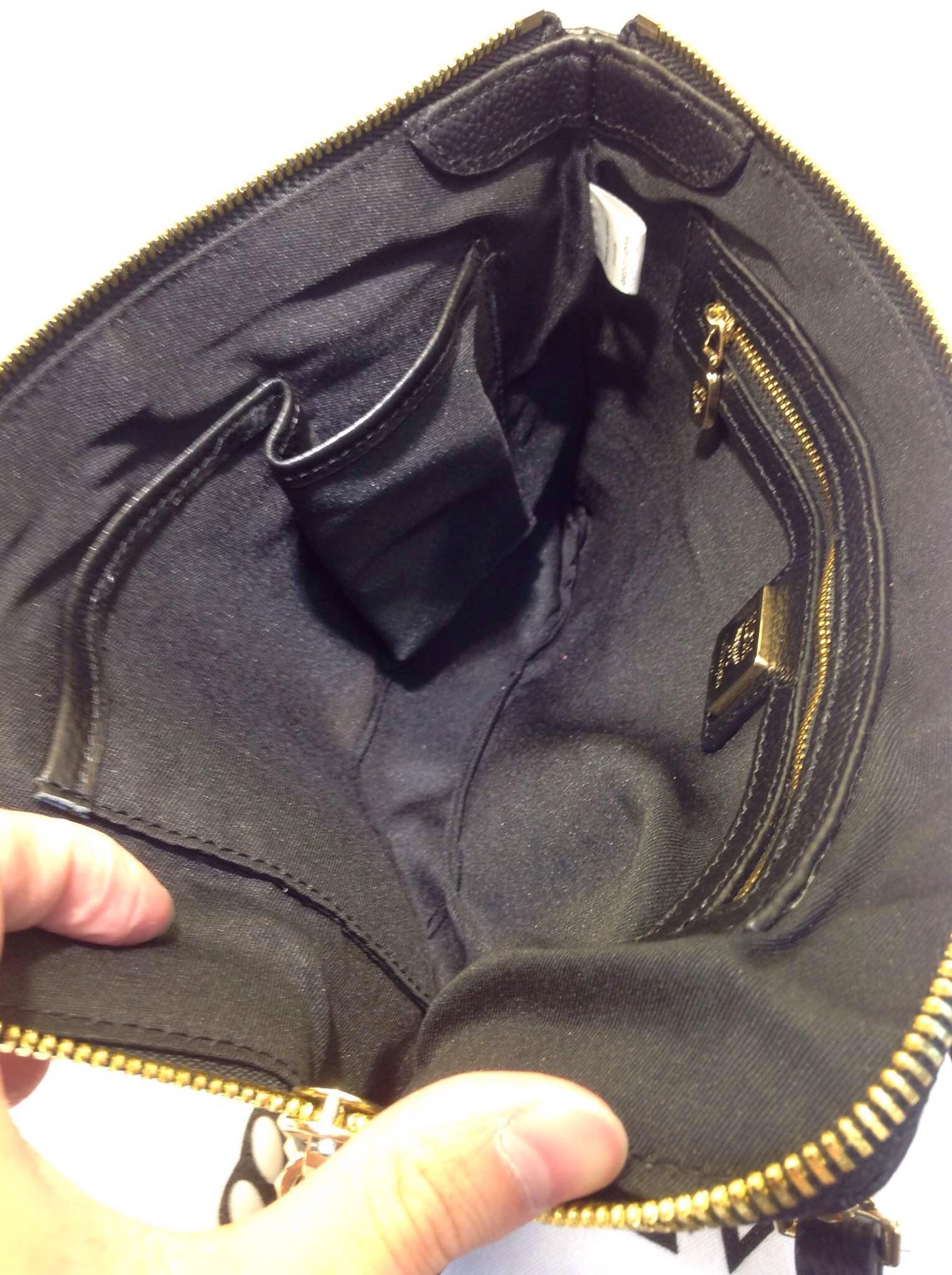 厂家直销 限量版mcm手包 铆钉手拿包 专柜品质