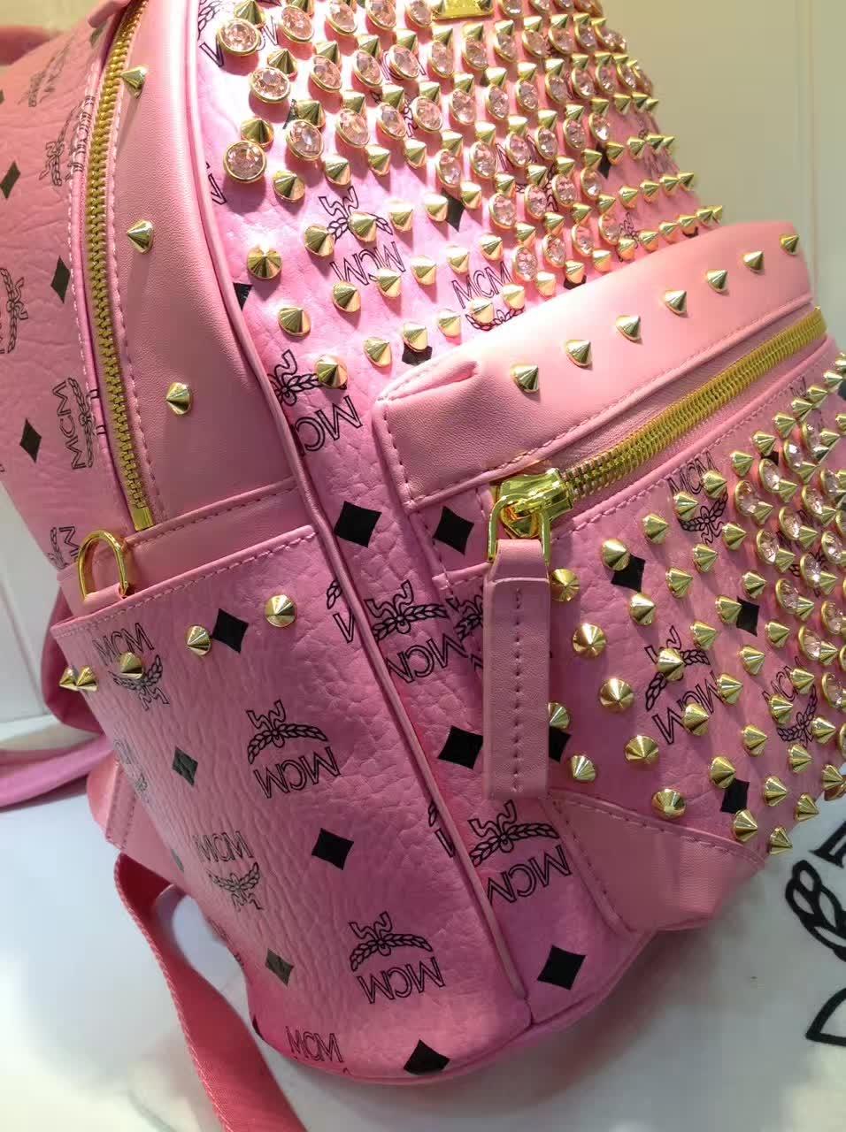 MCM包包批发 BIONIC系列背包 全新金属牌 耐用绒布内里 ykk拉链头配U型扣 粉色