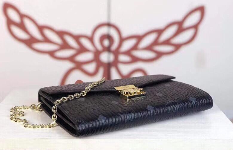 MCM Patricia系列 斜挎包单肩包折叠翻盖钱包 采用涂层帆布制成 风琴式隔层 黑色